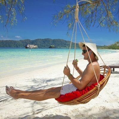 Man on tropical beach at Koh Rong S