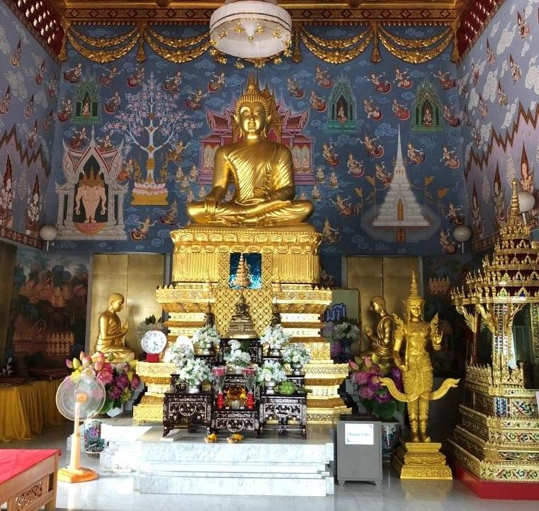 golden statue of a seated buddha