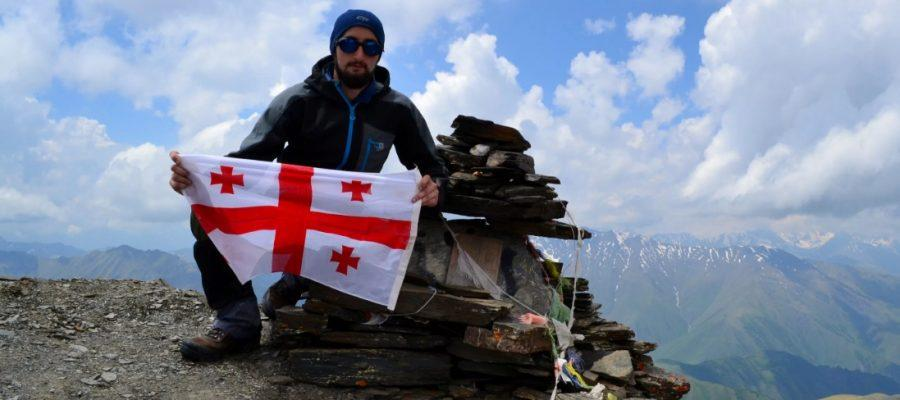 In the mountains with the flag of Georgia